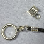 Leather crimp (top) can be used to attach a clasp to a string of leather (bottom)